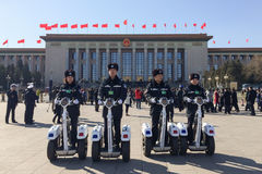 Policemen patrolling on Tiananmen Square in Beijing, China. Policemen patrolling on fashionable two-wheel vehicles on Tiananmen Square in Beijing during Chinas Stock Photo