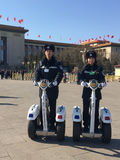 Policemen patrolling on Tiananmen Square in Beijing, China. Policemen patrolling on fashionable two-wheel vehicles on Tiananmen Square in Beijing during China's Royalty Free Stock Image