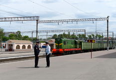 Policemen on the platform apron in Bryansk. BRYANSK, RUSSIA - MAY 14, 2015:Policemen on the platform apron in Bryansk Stock Photos