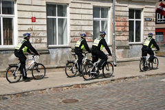 Policemen police on bicycles city Stock Photography