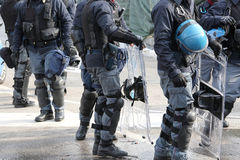 Policemen in riot gear with hardhat while patrolling the streets Stock Photo