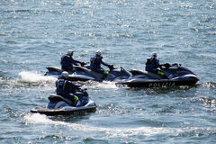Policemen on the sea. A group of italian policemen in the sea of naples on water motors Stock Photography