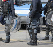 Policemen with shields and riot gear during the sporting event i. Many policemen with shields and riot gear during the sporting event in town Royalty Free Stock Image