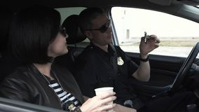 Police officers drinking coffee in car royalty free stock photos