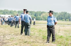 Policemen stand in cordon Royalty Free Stock Photo