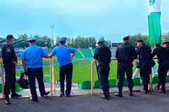 Policemen standing guard over order in the stadium during football match Royalty Free Stock Photo