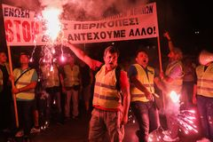 Policemen with torches, firefighters and port policeman protest. Thessaloniki, Greece - September 8, 2017: Policemen with torches, firefighters and port Royalty Free Stock Photography