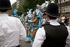 Policemen watch the carnival Stock Image
