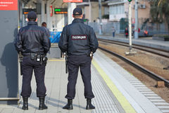 Policemens. SOCHI, RUSSIA - MAR, 8, 2014: The two police officers patrols the railway station Hosta. Increased security measures because of the Olympic winter Stock Images