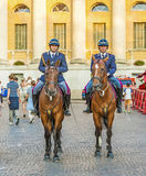 Policenmen with horses  watch the scenery at the entrance of the Stock Photo