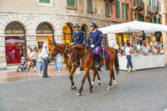Policenmen with horses  watch Royalty Free Stock Image