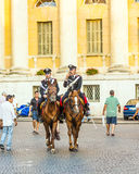 Policenmen with horses  watch Stock Photos