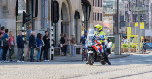 Policeofficer on Motorbike Royalty Free Stock Image