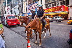 Policeofficer is riding his horse Royalty Free Stock Images