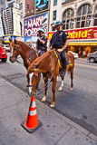 Policeofficer is riding his horse Stock Image