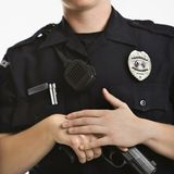 Policewoman with gun. Stock Photo