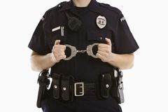 Policewoman with handcuffs. Stock Photography