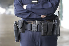 Policewoman with her uniform equipment belt. Royalty Free Stock Images