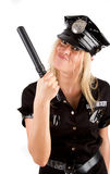 Policewoman holding a stick Royalty Free Stock Images