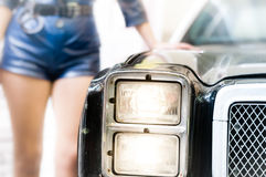 Policewoman leaning on the old police car. Stock Images