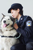 Policewoman and police dog. Chinese policewoman and  her police dog Stock Images