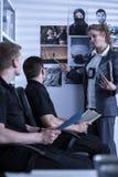 Policewoman presenting materials Stock Photos
