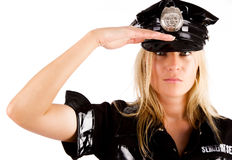 Policewoman is saluting royalty free stock photography