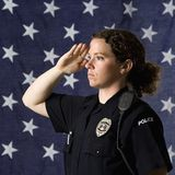 Policewoman saluting. Stock Images