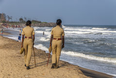 Policewomen at the beach in India Stock Photo