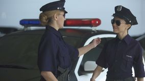 Policewomen giving high five and walking to police station, well done duty. Stock footage stock video