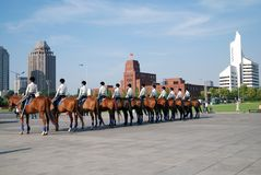Policewomen on Horse. A female ranger patroling on People Square in Dalian, China during the world economic forum (summer Davos Stock Photography