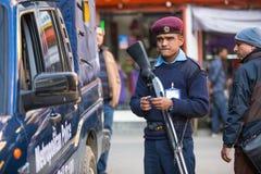 Policia durante o protesto dentro de uma campanha para terminar a violência contra as mulheres (VAW) Fotos de Stock Royalty Free