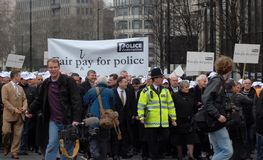 Policie o pagamento justo março Foto de Stock Royalty Free