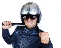 Policier dans l'uniforme avec son bâton de nuit Photo stock