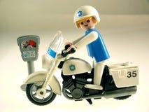 Policier de jouet sur le vélo Photographie stock