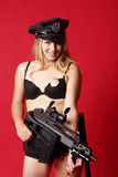 Policier sexy avec le canon Photographie stock libre de droits
