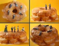 Policiers dans des images conceptuelles de nourriture avec des beignets Photographie stock