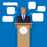 Policies behind the podium with speech bubbles Stock Images