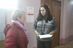 Policies Evgeniya Chirikova and candidate Natalia Alymova at a polling station in Khimki Royalty Free Stock Images