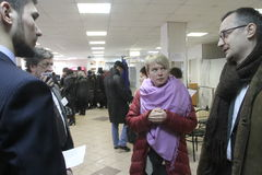 Policies Evgeniya Chirikova communicates with observers at the polling station Stock Photos
