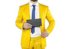 Policies in a gold suit boasts envelope Stock Photography