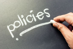Policies. Hand writing Policies topic on chalkboard Stock Images