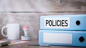 Policies and Procedure. Two binders on desk in the office. Business background stock video