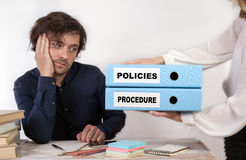 Policies and Procedure - two binders in the hands of women.  stock images