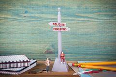 Policies and Procedures. Signpost on wooden table royalty free stock photos