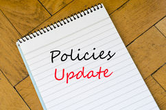 Policies update text concept. White notepad on the wooden background Stock Photo