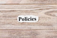 Policies of the word on paper. concept. Words of Policies on a wooden background stock photo