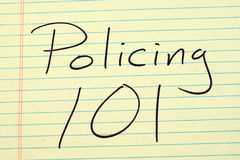 Policing 101 On A Yellow Legal Pad Royalty Free Stock Images