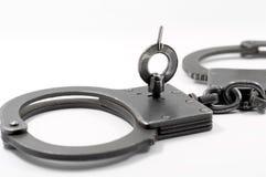Policja kajdanki na białym tle Zdjęcia Stock