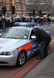 policja uczciwej rekompensaty marszu Fotografia Royalty Free
